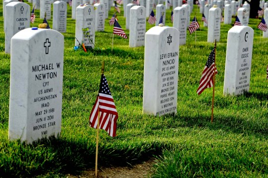 Old Guard soldiers plant flags at Arlington National Cemetery