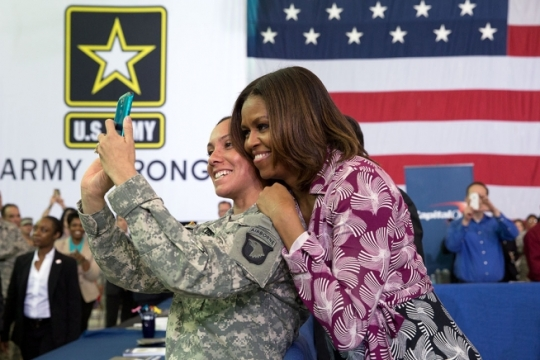 First Lady Michelle Obama poses for a selfie with a member of the audience after participating in a Joining Forces initiative event with service members, military spouses, and employers at the Fort Campbell Veterans Jobs Summit and Career Forum at Fort Campbell, Ky., April 23, 2014. (Official White House Photo by Amanda Lucidon)
