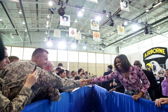 First Lady Michelle Obama greets members of the audience after participating in a Joining Forces initiative event at the Fort Campbell Veterans Jobs Summit and Career Forum at Fort Campbell, Ky., April 23, 2014. (Official White House Photo by Amanda Lucidon)
