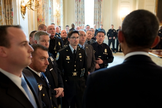 President Barack Obama addresses the recipients of the 2014 National Association of Police Organizations Top Cops lined up in the State Dining Room prior to a ceremony in the East Room of the White House, May 12, 2014. (Official White House Photo by Pete Souza)