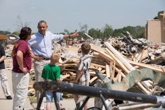 President Barack Obama talks with a family in tornado-ravaged Vilonia, Ark., May 7, 2014. (Official White House Photo by Pete Souza)