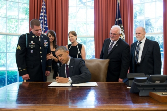 President Barack Obama signs the Medal of Honor award citation with Sergeant Kyle J. White and family in the Oval Office prior to a Medal of Honor ceremony in the East Room of the White House, May 13, 2014. (Official White House Photo by Pete Souza)