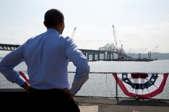 President Barack Obama views the new bridge under construction adjacent to the Tappan Zee Bridge after making remarks on infrastructure at the Washington Irving Boat Club in Tarrytown, N.Y., 2014. (Official White House Photo by Pete Souza)