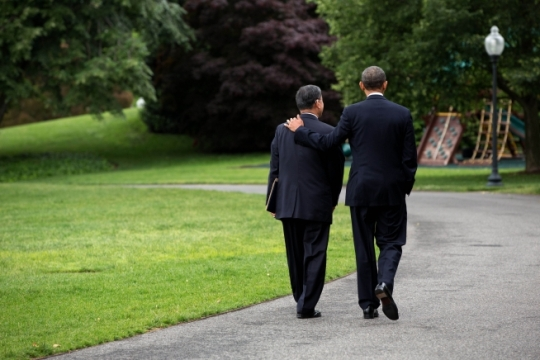 President Barack Obama walks with Veterans Affairs Secretary Eric K. Shinseki on the driveway of the South Grounds of the White House, May 30, 2014. The President accepted Shinseki's resignation and named Sloan D. Gibson, United States Deputy Secretary of Veterans Affairs as Acting Secretary of Veterans Affairs. (Official White House Photo by Pete Souza)