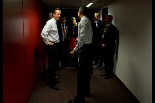 President Barack Obama talks in a hallway with British Prime Minister David Cameron following their bilateral meeting at the G7 Summit in Brussels, Belgium, June 5, 2014. (Official White House Photo by Pete Souza)