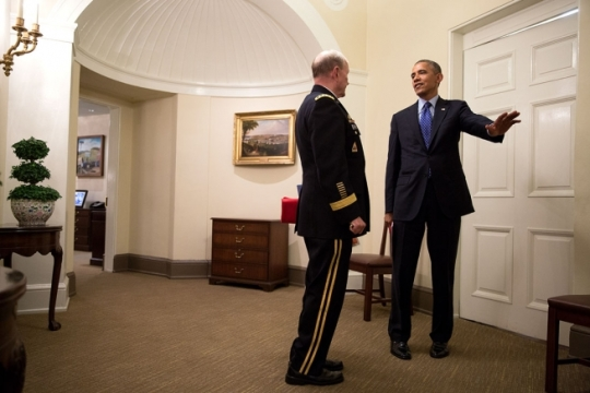 President Barack Obama talks with Gen. Martin Dempsey, Chairman of the Joint Chiefs of Staff, outside the Oval Office following a meeting in the Situation Room of the White House, June 19, 2014. (Official White House Photo by Pete Souza)