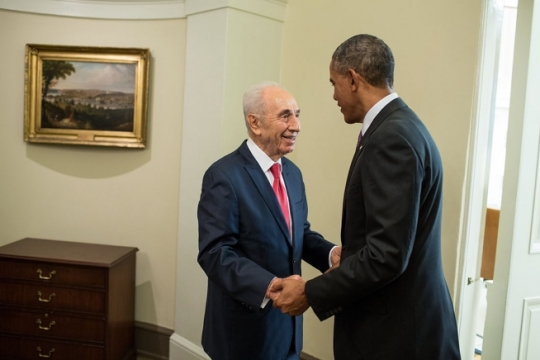 President Barack Obama greets President Shimon Peres of Israel in the hallway outside the Oval Office, June 25, 2014. (Official White House Photo by Pete Souza)