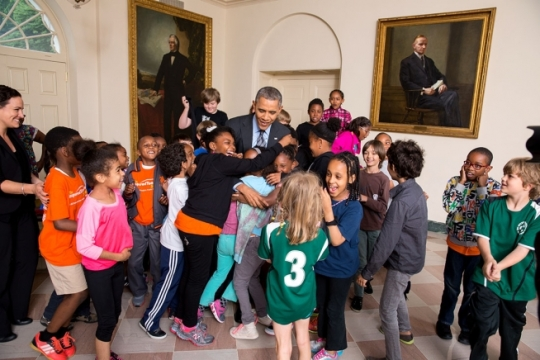 President Barack Obama greets White House Healthy Kids & Safe Sports Concussion Summit participants in the East Garden Room of the White House, May 29, 2014. The President met with the group indoors when their South Lawn event was cancelled due to weather. (Official White House Photo by Chuck Kennedy)