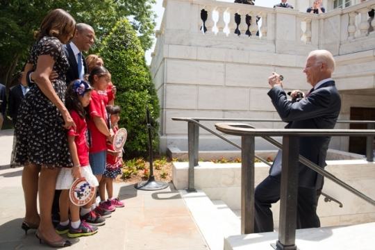 Vice President Joe Biden takes a photo with a cell phone of President Barack Obama, First Lady Michelle Obama, and TAPS Kids on departure from Arlington National Cemetery, in Arlington, Va., May 26, 2014. (Official White House Photo by Chuck Kennedy)