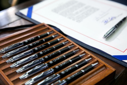 Pens to be used by the President are set on the signing table with the bill prior to President Barack Obama signing H.R. 803, the Workforce Innovation and Opportunity Act, in the Eisenhower Executive Office Building South Court Auditorium, July 22, 2014. (Official White House Photo by Amanda Lucidon)