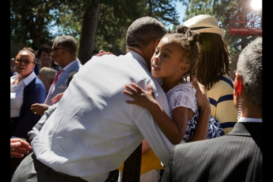 President Barack Obama hugs a young girl in the audience following his remarks on the economy at Cheesman Park in Denver, Colorado, July 9, 2014. (Official White House Photo by Pete Souza)