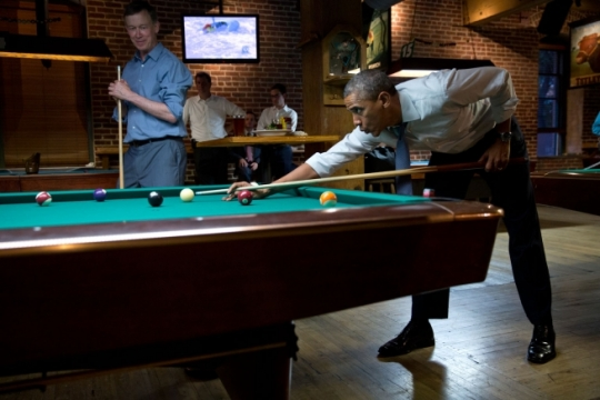 President Barack Obama whistles along to the music as he shoots pool with Colorado Gov. John Hickenlooper in Denver, Colorado, July 8, 2014. (Official White House Photo by Pete Souza)