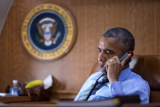 President Barack Obama talks on the phone aboard Air Force One with President Petro Poroshenko of Ukraine about the Malaysia Airlines plane crash in eastern Ukraine, July 17, 2014. (Official White House Photo by Pete Souza)