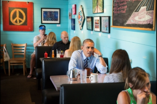 President Barack Obama talks with Kinsey Button at the Magnolia Cafe in Austin, Texas, July 10, 2014. (Official White House Photo by Pete Souza)