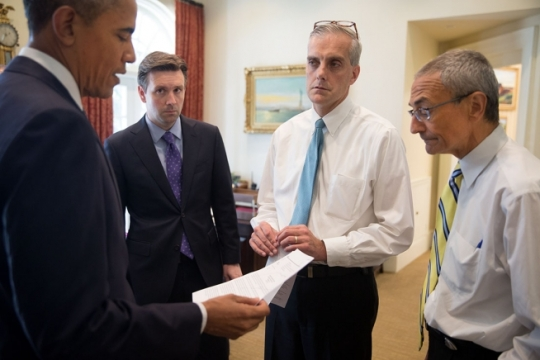 President Barack Obama talks with Press Secretary Josh Earnest, Chief of Staff Denis McDonough, and John Podesta, Counselor to the President, in the Outer Oval Office before delivering a statement on the crash of Malaysia Airlines Flight 17 and the situation in Ukraine, July 18, 2014. (Official White House Photo by Pete Souza)