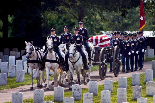 The funeral procession of U.S. Army Maj. Gen. Harold J. Greene processes through Arlington National Cemetery during a military funeral in his honor at Joint Base Myer-Henderson Hall's Memorial Chapel in Arlington, Va., Aug. 14, 2014. Greene is the highest-ranking service member killed in the wars in Iraq and Afghanistan. (U.S. Army photo by Staff Sgt. Bernardo Fuller)