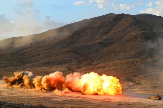 U.S. Army Soldiers from 1st Armored Brigade Combat Team, 3rd Infantry Division, detonate a M58 Mine Clearing Line Charge during Decisive Action Rotation 14-09 at the National Training Center here, Aug. 10, 2014. Decisive action rotations are reflective of the complexities of potential adversaries our nation could face and include: guerrilla, insurgent, criminal, and near-peer conventional forces woven into one dynamic environment. (U.S. Air Force photo by Senior Airman Daniel Hughes, 1st Combat Camera Squadron)