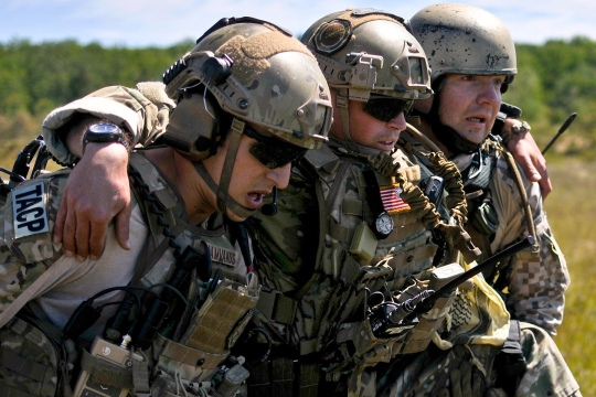 U.S. Air Force Senior Airman Thomas Vamvakos (left), a tactical air control party specialist with the 169th Air Support Operations Squadron, and Latvian Cpl. Janis Gabranis (right), a TACP with the Latvian National Armed Forces, carry Senior Airman Lance A. Liggett to a medical evacuation point after a simulated roadside bomb explosion at Operation Northern Strike in Grayling Air Gunnery Range, Grayling, Mich., Aug. 14, 2014. Northern Strike was a three-week-long exercise led by the National Guard that demonstrated the combined power of joint and multinational air and ground forces. TACPs with the Air National Guards 169th ASOS from Peoria, Ill., and more than 5,000 other armed forces members from 12 states and two coalition nations participated in the combat training. (U.S. Air National Guard photo by Staff Sgt. Lealan Buehrer/Released)