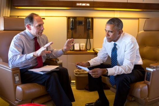 President Barack Obama talks with Veterans Affairs Secretary Robert A. McDonald aboard Air Force One on the flight to Charlotte, North Carolina, to address the American Legion's 96th National Convention, Aug. 26, 2014. (Official White House Photo by Pete Souza)