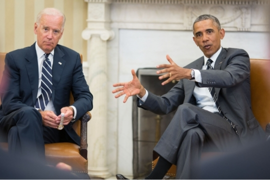 President Barack Obama, with Vice President Joe Biden, gestures during a meeting in the Oval Office, Aug. 27, 2014. (Official White House Photo by Pete Souza)