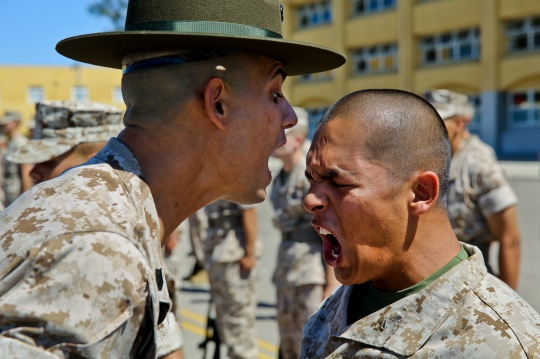 Recruit Benjamin J. Flores gets corrected by his drill instructor after he got a question wrong during an Inspection at Marine Corps Recruit Depot San Diego, Aug. 4, 2014. Before the commander steps in front of recruits, their drill instructors inspect them to ensure that they are ready. Flores is assigned to Alpha Company, 1st Recruit Training Battalion.