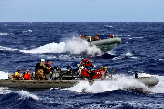 Navy sailors return to the USS San Diego on rigid inflatable boats with researchers with the National Oceanic and Atmospheric Administration as part of a recovery mission, Aug. 8, 2014. The sailors, assigned to the USS San Diego, and the Marines, assigned to the 11th Marine Expeditionary Unit, recovered 11 personnel from three isolated islands.