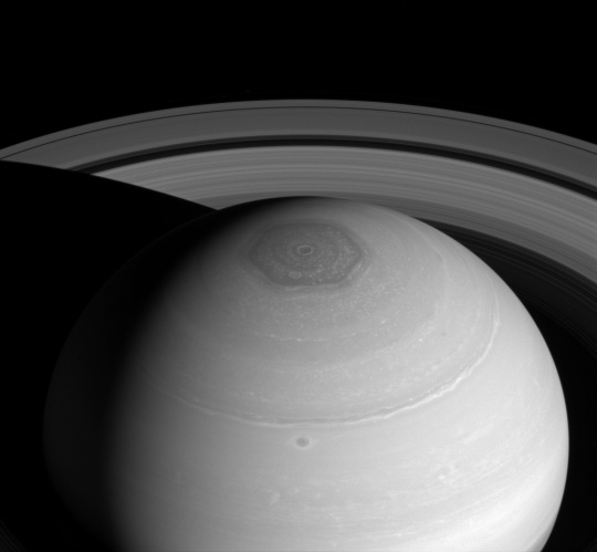 The Cassini spacecraft captures three magnificent sights at once: Saturn's north polar vortex and hexagon along with its expansive rings.   Photo Courtesy:  DOD Armed with Science.