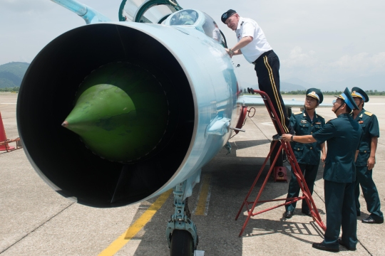 Gen. Martin E. Dempsey, chairman of the Joint Chiefs of Staff, is shown one of the trainer jets used by Vietnam Air Division 372 in Da Nang, Vietnam, Aug. 15, 2014.  DOD photo by D. Myles Cullen (released)