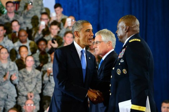 President Barack Obama shakes hands with Army Gen. Lloyd J. Austin III, commander of U.S. Central Command, on MacDill Air Force Base in Tampa, Fla., Sept. 17, 2104. Obama traveled to the base to speak with troops and meet with Centcom leaders to discuss the fight against the Islamic State in Syria and the Levant. Defense Secretary Chuck Hagel, center back, attended the event.
