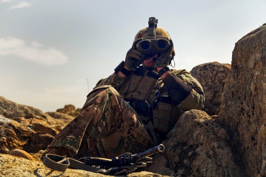 A U.S. Army Soldier Sgt. Jacob Baker of 2nd Platoon Apache Troop 1/75th Cavalry Battalion, 2nd Brigade, 101st Airborne Division (Air Assault) uses high ground to overlook Parwan province, Afghanistan, for possible threats.