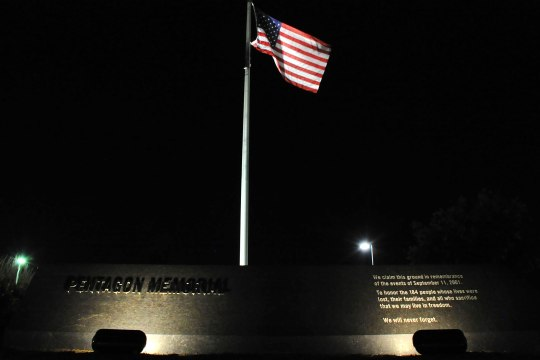 Lights illuminate the American flag at the National 9/11 Pentagon Memorial in Arlington, Va., Sept. 10, 2014.  The Pentagon Memorial was created to remember and honor those lost at the Pentagon Sept. 11, 2001.  (U.S. Coast Guard photo by Petty Officer 2nd Class Patrick Kelley.)