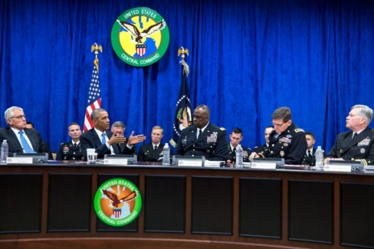 President Barack Obama receives a briefing from Gen. Lloyd J. Austin III, Commander, U.S. Central Command, and his top commanders at U.S. Central Command at MacDill Air Force Base in Tampa, Fla., Sept. 17, 2014. (Official White House Photo by Pete Souza)