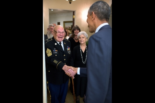 President Barack Obama greets retired Army Command Sgt. Major Bennie Adkins and family in the Oval Office before awarding him the Medal of Honor at a ceremony in the East Room of the White House, Sept. 15, 2014. President Obama also awarded the Medal of Honor posthumously to Army Specialist Four Donald Sloat. (Official White House Photo by Pete Souza)
