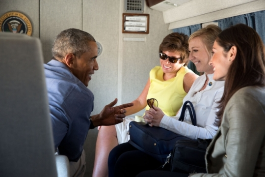 President Barack Obama talks with staff aboard Marine One enroute from the White House to Joint Base Andrews on Labor Day, Sept. 1, 2014. From left, Senior Advisor Valerie Jarrett, Deputy Chief of Staff Anita Breckenridge, and Deputy Press Secretary Jennifer Friedman. (Official White House Photo by Pete Souza)