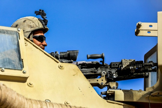 U.S. Marine Cpl. Miguel A. Menjivaguerra, a turret gunner with Weapons Company, 1st Battalion, 2nd Marine Regiment, observes his surroundings during a security patrol in Shorab, Helmand province, Afghanistan on September 20, 2014. Patrols are conducted to disrupt enemy operations against the Bastion-Leatherneck complex. (Official U.S. Marine Corps photo by Cpl. John A. Martinez Jr. / Released)