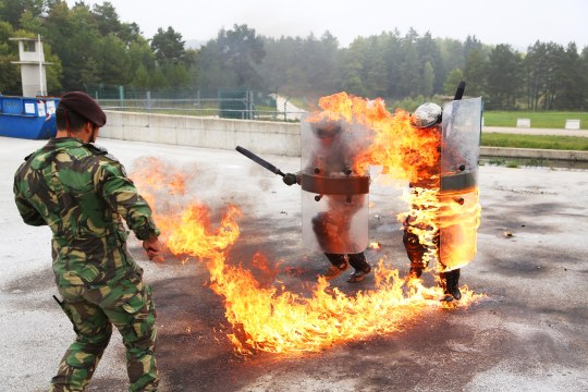 U.S. Soldiers of 1st Battalion, 40th Cavalry Regiment conduct fire phobia training during Rotation 14-09 at the Joint Multinational Readiness Center (JMRC) in Hohenfels, Germany, Oct. 4, 2014. The rotation is based on the current operational environment and is designed to prepare the unit for peace support, stability, and contingency operations. (U.S. Army photo by Spc.Tyler Kingsbury/Released)