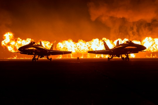"""The """"Great Wall of Fire"""" is displayed during the Marine Corps Community Services (MCCS) sponsored 2014 Air Show aboard Marine Corps Air Station (MCAS) Miramar, San Diego, Calif., Oct. 4, 2014. The air show showcases civilian performances and the aerial prowess of the armed forces but also, their appreciation of the civilian community's support and dedication to the troops. (U.S. Marine Corps photo by Lance Cpl. Trever Statz/Released)"""
