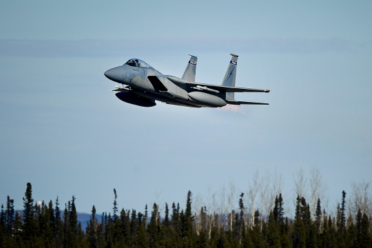 A 125th Fighter Wing U.S. Air Force F-15 Eagle takes flight during exercise Vigilant Shield 15 at 5 Wing Goose Bay, Newfoundland and Labrador, Oct. 23, 2014. The Vigilant Shieldfield training exercise is a bi-national NORAD Command exercise which provides realistic training and practice for American and Canadian forces in support of respective national strategy for North America's defense. NORAD ensures U.S. and Canadian air sovereignty through a network of alert fighters, tankers, airborne early warning aircraft, and ground-based air defense assets cued by interagency and defense surveillance radars. (U.S. Air Force photo by Tech. Sgt. Brandon Shapiro/Released)