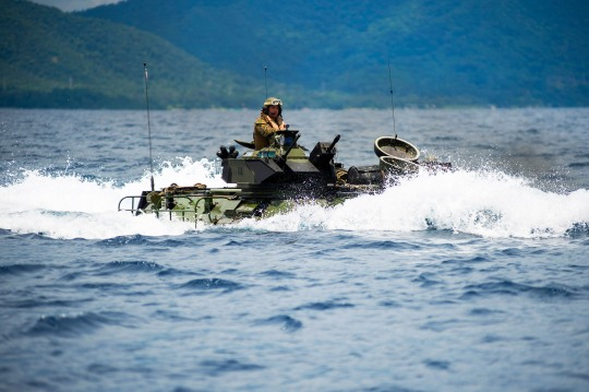 141002-N-XM324-101 SULU SEA (Oct. 2, 2014) Marines assigned to the 31st Marine Expeditionary Unit (31st MEU) maneuver an amphibious assault vehicle towards the amphibious dock landing ship USS Germantown (LSD 42) during the Amphibious Landing Exercise 2015 (PHIBLEX15). PHIBLEX15 is an annual bilateral training exercise conducted with the Armed Forces of the Philippines. Germantown is part of the Peleliu Expeditionary Strike Group and is conducting joint forces exercises in the U.S. 7th Fleet area of responsibility. (U.S. Navy photo by Mass Communication Specialist Seaman Patrick Dionne/Released