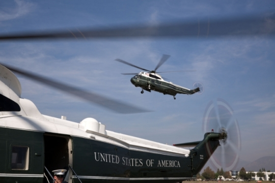 Framed by Nighthawk Two, Marine One comes in for landing at the Brackett Field landing zone in San Dimas, Calif., Oct. 10, 2014. (Official White House Photo by Pete Souza)