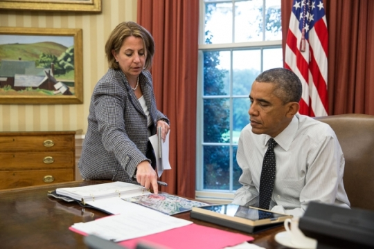 Lisa Monaco, Assistant to the President for Homeland Security and Counterterrorism, updates President Barack Obama on the shooting in Canada prior to his phone call with Prime Minister Stephen Harper, Oct. 22, 2014. (Official White House Photo by Pete Souza)
