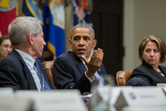 President Barack Obama speaks to Dr. Anthony Fauci, Director of The National Institute of Allergy and Infectious Diseases at the National Institute of Health during a meeting with members of the President's Council of Advisors on Science and Technology regarding Ebola, in the Roosevelt Room of the White House, Oct. 23, 2014. (Official White House Photo by Pete Souza)