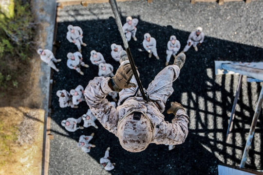 U.S. Marine Sgt. Andrew Shelly rappels from a tower during a helicopter rope-suspension techniques masters course aboard Camp Pendleton, Calif., Oct. 14, 2014. Shelly is a machine gunner with Battalion Landing Team, 3rd Battalion, 1st Marine Regiment, 15th Marine Expeditionary Unit.  BLT 3/1 is deploying this spring as the 15th MEU's ground combat element. (U.S. Marine Corps photo by Cpl. Steve H. Lopez/Released)