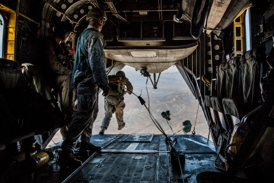 A U.S. Marine with Force Reconnaissance Detachment, 15th Marine Expeditionary Unit, jumps out of a CH-53E Super Stallion aircraft during airborne-sustainment training aboard Camp Pendleton, Calif., Oct. 21, 2014. The Force Recon Detachment is scheduled to deploy with the 15th MEU next spring. (U.S. Marine Corps photo by Sgt. Emmanuel Ramos/Released)