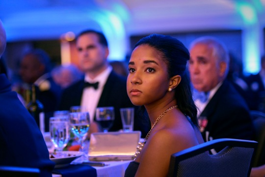 Guests look on from their tables as Secretary of Defense Chuck Hagel delivers opening remarks at the 2014 USO Gala held in Washington, D.C. Oct. 17, 2014. DoD Photo by Glenn Fawcett (Released)