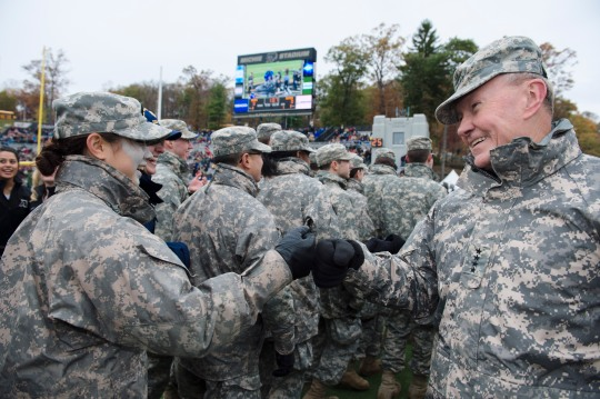 Chairman of the Joint Chiefs of Staff Gen. Martin E. Dempsey bumps fists with a U.S. Military Academy cadet during an Army versus Air Force football game at Michie Stadium, West Point, N.Y., Nov. 1, 2014.  Air Force beat Army 23-6 winning the Commander-in-Chief's trophy for the 19th time (DoD Photo by Mass Communication Specialist 1st Class Daniel Hinton/Released)