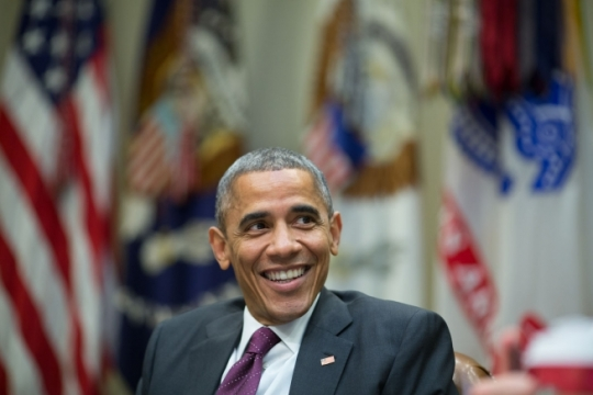 President Barack Obama shares a laugh with senior advisors during a meeting in the Roosevelt Room of the White House, Nov. 17, 2014. (Official White House Photo by Pete Souza)