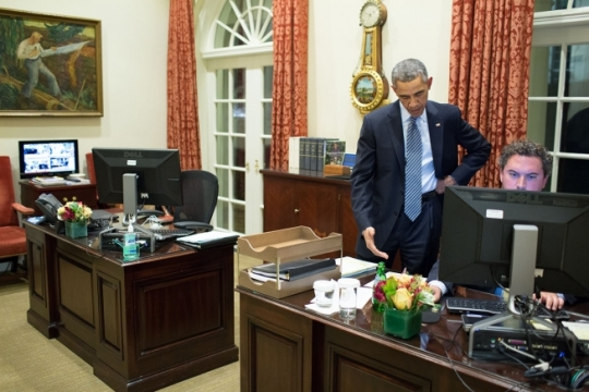 President Barack Obama works on a press statement with Director of Speechwriting Cody Keenan, in the Outer Oval Office, Nov. 24, 2014, following the grand jury's decision not to indict a Ferguson, Missouri police officer in the August shooting of Michael Brown. (Official White House Photo by Pete Souza)