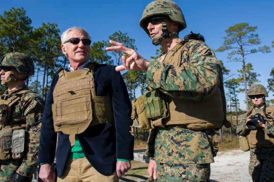 Camp Lejeune, N.C. (Nov. 18, 2014) -- Defense Secretary Chuck Hagel observes female marines assigned to Ground Combat Element Integrated Task Force firing the Shoulder-Launched Multipurpose Assault Weapon (SMAW) on Camp LeJeune, N.C., Nov. 18. 2014. DoD photo by Petty Officer 2nd Class Sean Hurt/Released