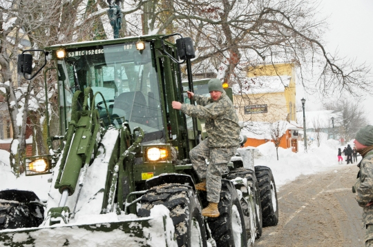 New York Army Guardsmen use engineering equipment to help remove snow in Buffalo, N.Y., Nov. 20, 2014. New York Gov. Andrew M. Cuomo called up about 375 Guardsmen to support response and recovery efforts following historic amounts of snowfall in the area.